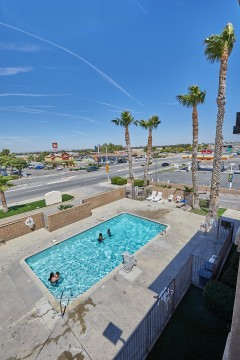 Welcome To EZ8 Palmdale Motel - Sparkling Pool